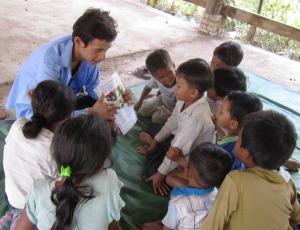 Sopheap teaching children at Krasang Paem Village
